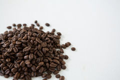 Pile of roasted coffee beans. On white background Royalty Free Stock Photography