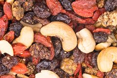 Mixture of cashew seeds and sweet dried berries close-up royalty free stock photography