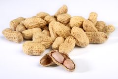 Pile of roasted peanuts. Pile of peanuts isolated on white Royalty Free Stock Photography