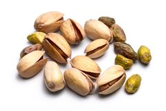 Pile of roasted pistachio nuts. Pistacia vera isolated on white Royalty Free Stock Photos