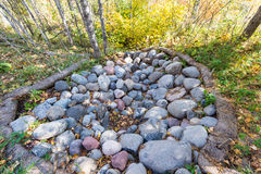 Pile of rock. A pile of rock in a public park during autumn Stock Image