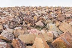 Pile of rocks for breakwater. Of dam stock photos