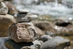 Pile of rocks at a creek Stock Images