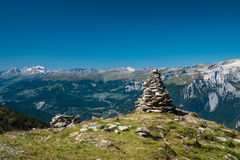 A pile of rocks in front of mountains. Some artist must have made a sculpture out of rocks on this mountain Stock Images