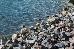 Pile of rocks on lakeside Royalty Free Stock Photos