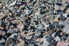 Pile of rocks on lakeside Stock Image