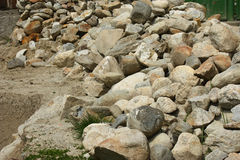 Pile of rocks recovered from an old building. Stock Photos