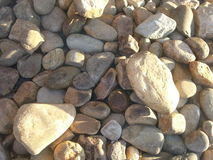 Pile of rocks. Pile of river rocks for decoration along side a business Royalty Free Stock Photos