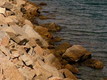 Pile of rocks on the sea. That act as a barrier royalty free stock images