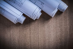 Pile of rolled construction plans architecture and building conc Stock Images