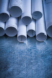 Pile of rolled engineering drawings on scratched Stock Photo