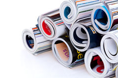 Pile of rolled magazines. Pile of colorful rolled magazines; isolated on white background Stock Photos