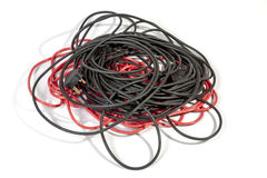 Pile of Rolled Red and Black Electric Extension Cables Stock Image