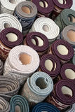 Pile of rolled up carpets. On a flea market Royalty Free Stock Image