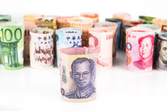 Pile of rolled-up currency notes with Thailand Baht in front Royalty Free Stock Photos