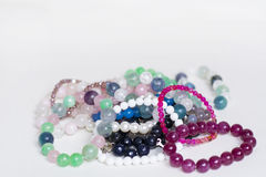 Pile of Rose and green quartz bracelets Stock Photos