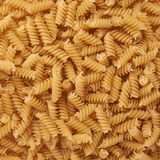 Pile of rotini yellow pasta as abstract background Stock Photography
