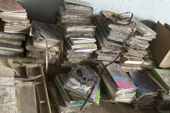 Pile of rotting books. And film reels Royalty Free Stock Photos