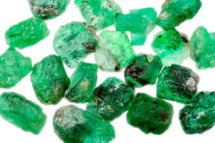 A pile of rough uncut green emeralds royalty free stock photos