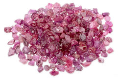 A pile of rough uncut pink red ruby royalty free stock image