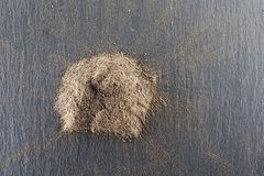 Pile of roughly milled black pepper spice.Top view. Top view on the pile of roughly milled black pepper spice Stock Image