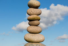 Pile of round smooth stones  in sunlight Stock Photography