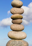 Pile of round smooth stones  in the sunlight Royalty Free Stock Image