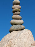 Pile of round smooth stones  in the sunshine Stock Image