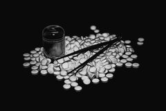 Heap of white pills. Pile of round tablets on a black background. Illustration Stock Photography