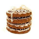 Pile of gingerbread with white glazing in sun shape with a thread isolated on white with clipping path. Pile of rounds gingerbread with white glazing in sun royalty free stock image