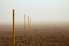Pile row on foggy beach Royalty Free Stock Photography
