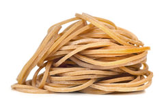 Pile of Rubber Bands over White Stock Images