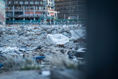 A pile of rubble, garbage, and trash on a construction site stock images