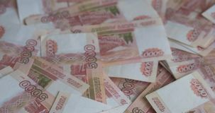 Russian money roubles banknotes, heap of russian rubles. A pile of russian money. Russian roubles banknotes, currency background stock footage