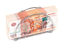 Pile of russian roubles bills. Napkin holder with pile of russian roubles bills Royalty Free Stock Photography