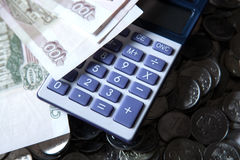 Pile of Russian rubles with calculator. Close up royalty free stock images