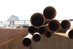 Pile of rusty metal pipes Stock Photo