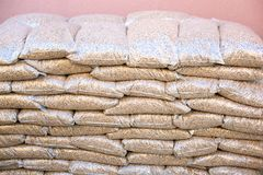 Pile of sacks ful with wooden pellets Stock Photos