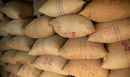 Pile of sacks stored in warehouse Stock Image