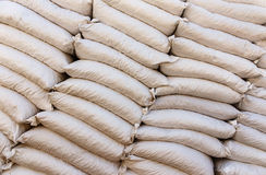 Pile sacks in warehouse Stock Photo