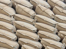 Pile sacks in warehouse Stock Images