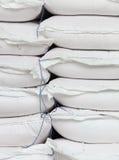 Pile sacks in warehouse Stock Photo