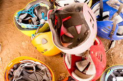 Pile of safety helmets. Pile of used, scratched safety helmets used for mountaineering and other adventure sports Stock Image