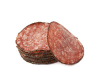 Pile of salami slices isolated Stock Photos