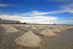 Pile of salt on farm against blue sky Stock Images