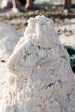 Pile of salt. A hill of salt sprinkled on a salt beach Royalty Free Stock Images