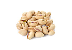 Pile of salted pistachio nuts on white Royalty Free Stock Image