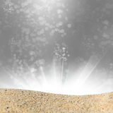 A pile of sand on a beach against the abstract bokeh background Stock Image