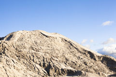 Pile of sand and blue sky over it Stock Image