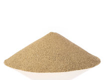 Pile of sand. Isolated on white royalty free stock images
